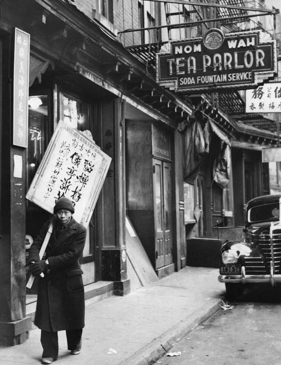 A Chinese 'sandwich board man' walks the streets of Chinatown in New York bearing the latest war news - 1938
