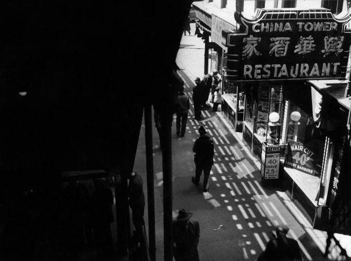 An intersection of the Bowery and Chinatown, 1940s